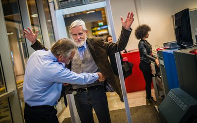 Man going through security at the airport