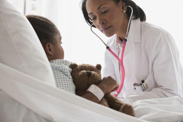 Doctor examining young girl