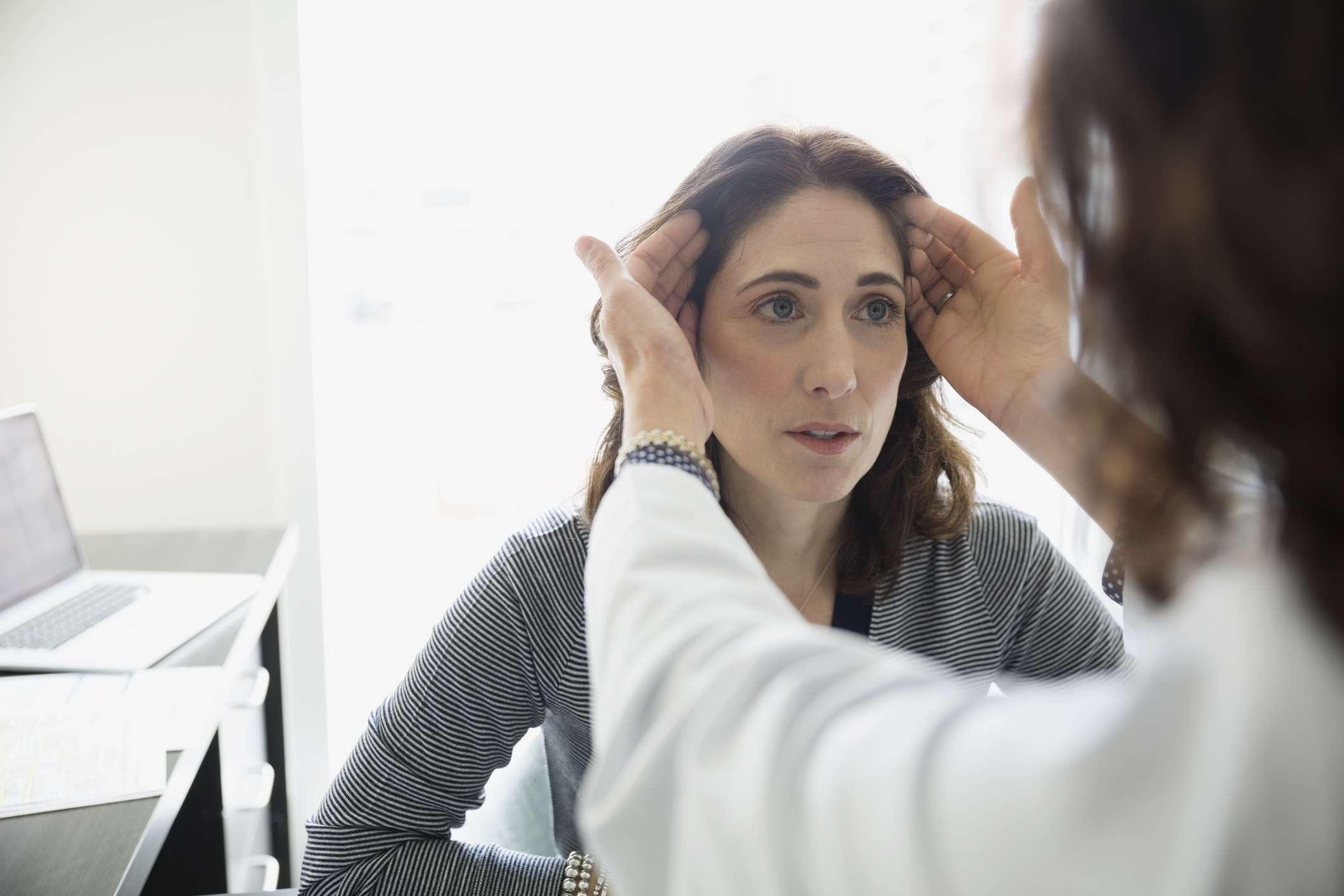 Plastic surgeon consulting female patient