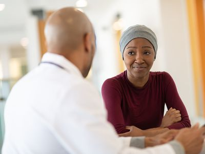Young female cancer patient meets with doctor