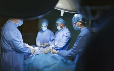 Operating room staff performing hospital surgery