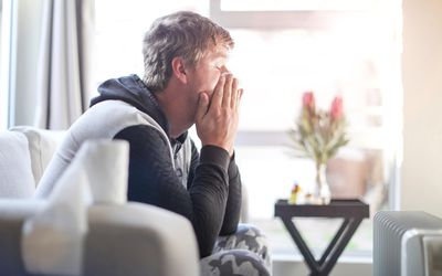 an Adult male sick at home.