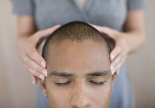 A man getting his head massaged
