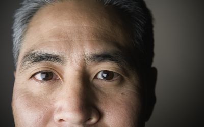 Extreme closeup of middle-aged Asian man