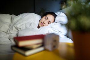 Woman cozy in her bedroom