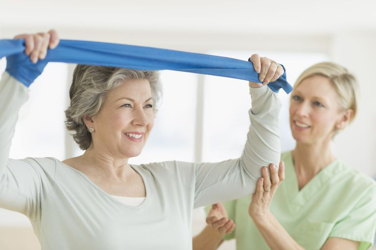 Woman performing a shoulder exercise as part of her physical therapy