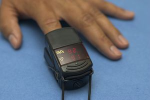 Hand with pulse oximeter