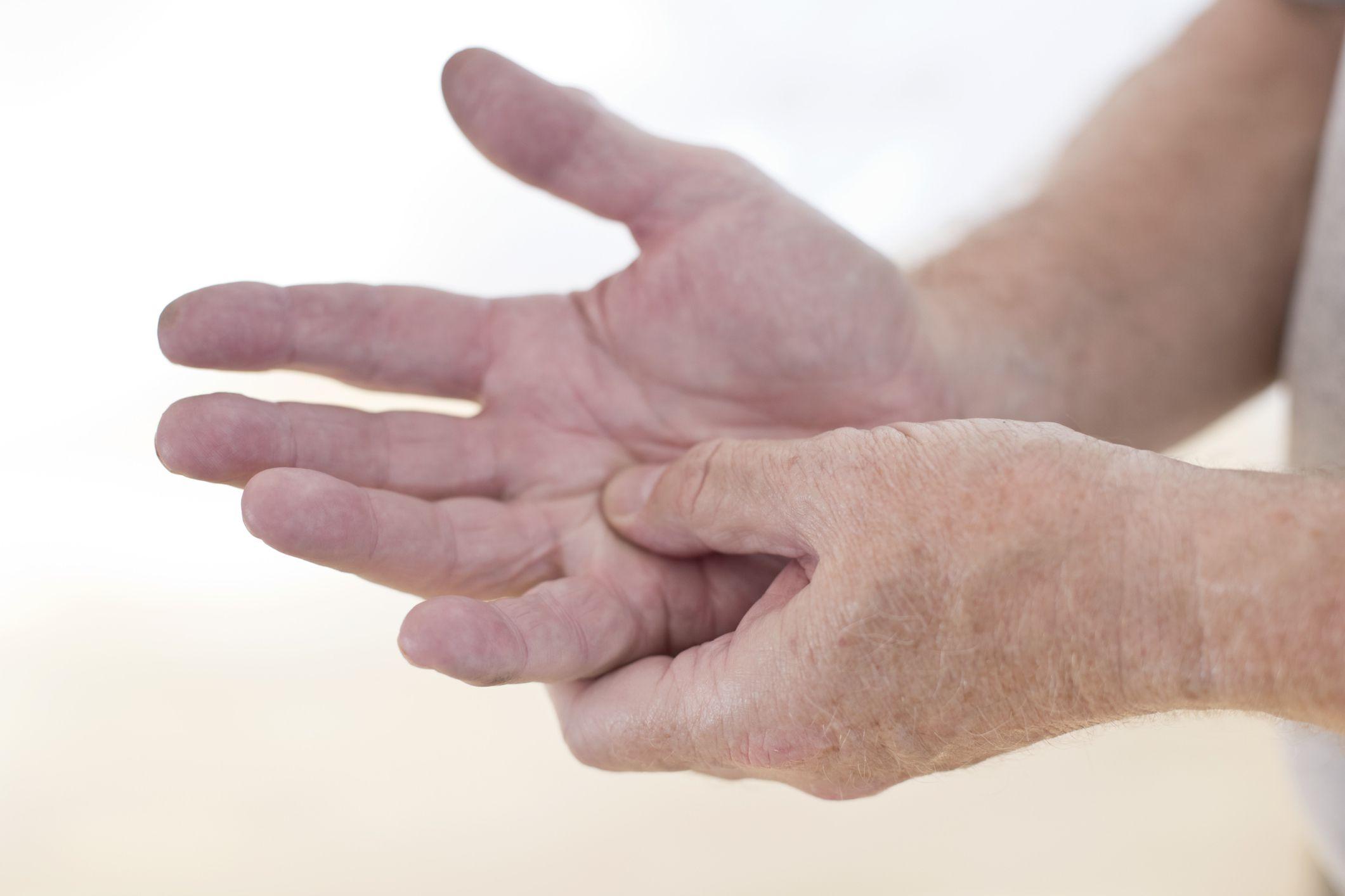 Man rubbing sore hand