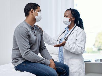 Doctor and patient in exam room