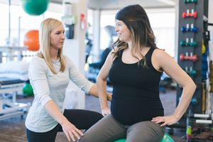 Pregnant woman doing exercises in a physiotherapy clinic