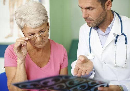 doctor talking with a patient about limited stage small cell lung cancer