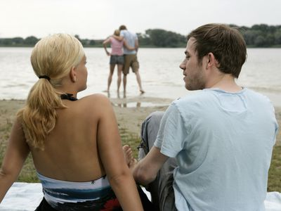 Two couples on a date at the lake.