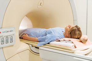 Female patient receiving MRI scan