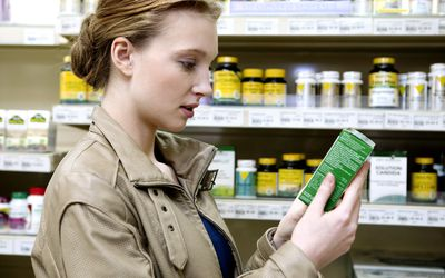 Woman looking at allergy medication