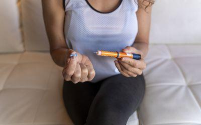 Woman injecting insulin.