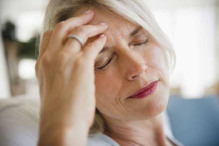 Older woman with headache