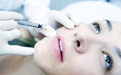 woman getting facial dermal fillers