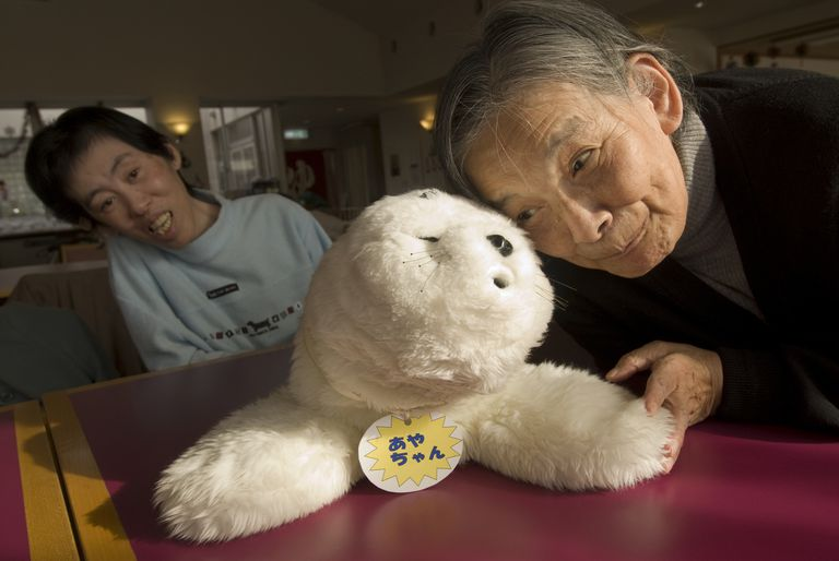 Paro the seal with two older women