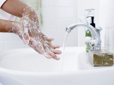 Soapy hands at sink