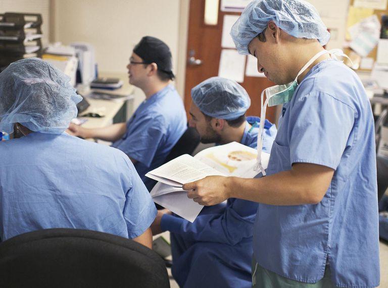 Nurses study medical text book
