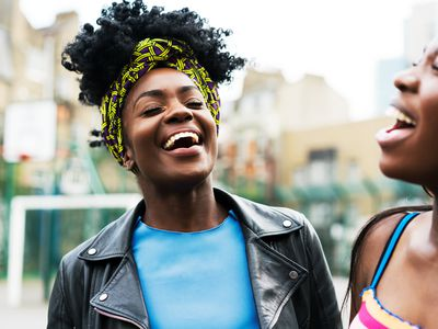 two young ladies laughing together
