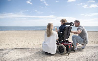 Child in wheelchair with parents
