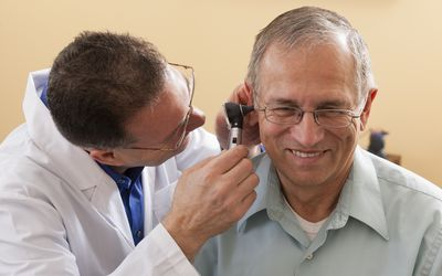 ENT doing an ear canal inspection