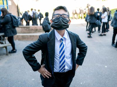 A child wearing a face mask poses for a photograph at Llanishen High School on September 20, 2021 in Cardiff, Wales.