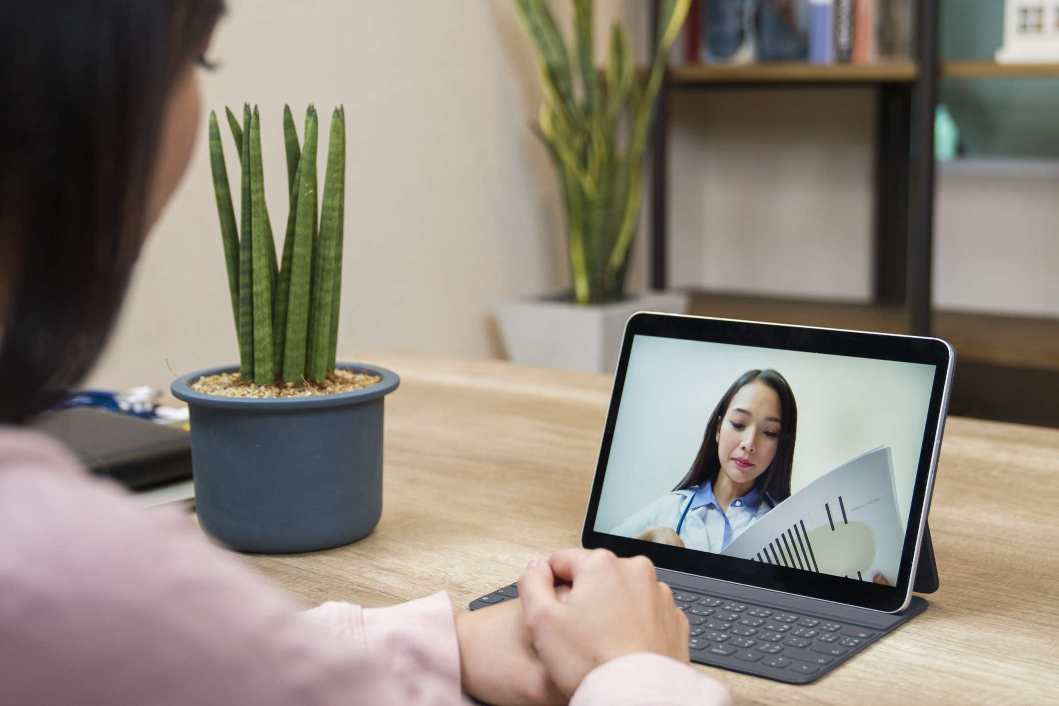 Young woman having online meeting with female healthcare provider