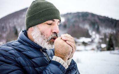 Mature Man Outdoors in Nature on a Cold Winter Day