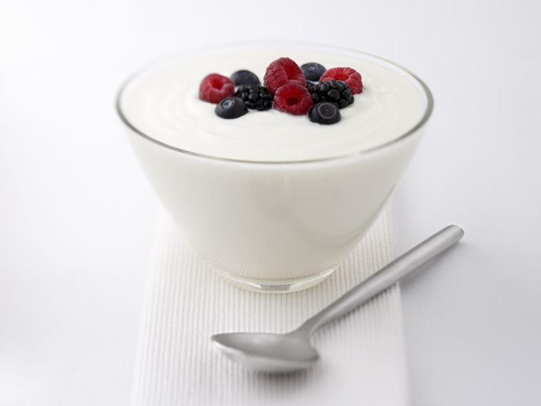 bowl of yogurt with berries on top