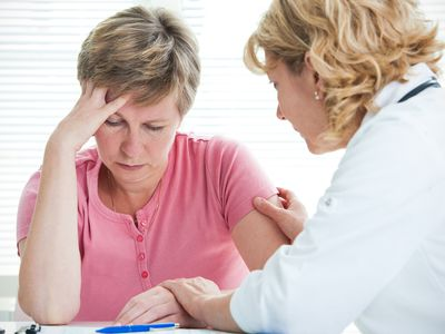 Doctor and patient discussing symptoms and diagnosis