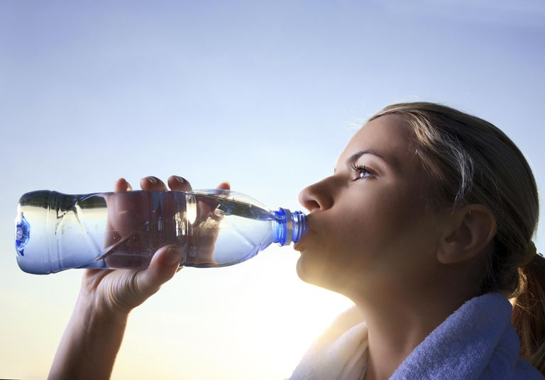 Female drinking mineral water.