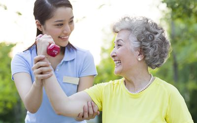 Physical therapist working with older woman