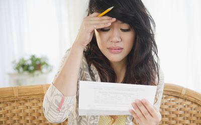 Frustrated woman paying shared responsibility payment