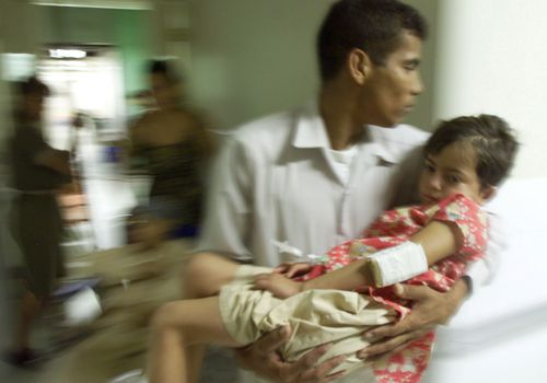 A child with Dengue fever during a 2002 outbreak in Honduras