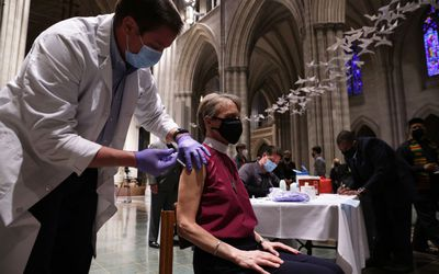 Clergy getting vaccinated.