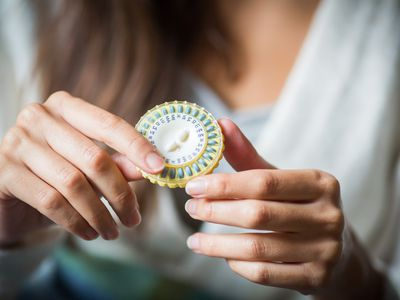 a woman with birth control pills