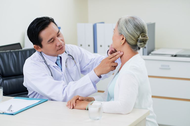 doctor checking a woman's neck