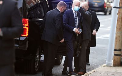 Joe Biden getting out of car two different shoes