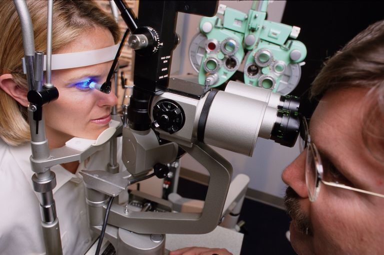Young woman having eye test, close-up