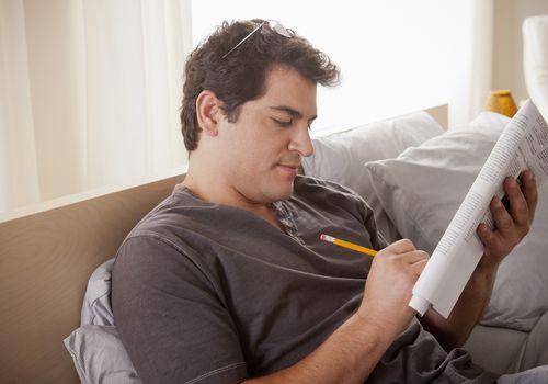 Crossword puzzle in bed