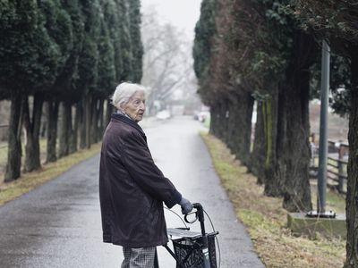 Elderly woman walking outside