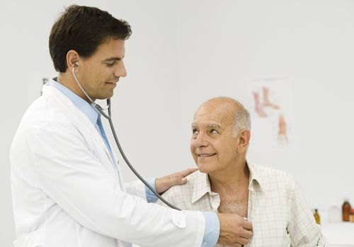 Doctor listening to a patient's heart