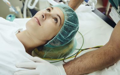 woman being prepared for surgery