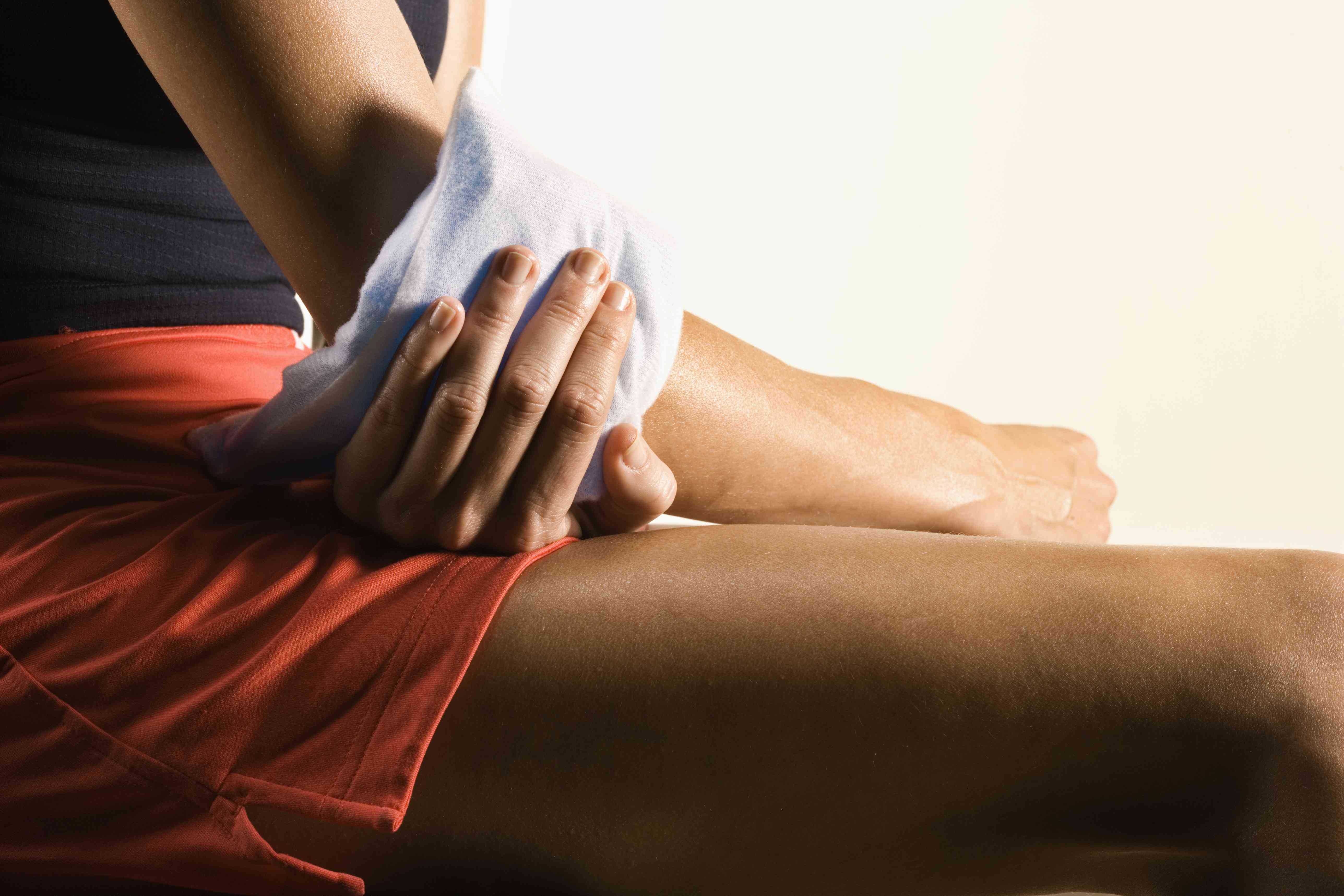 Woman with ice pack on elbow