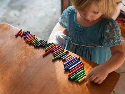 Child lining up blocks