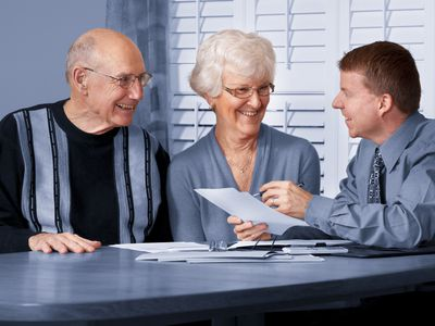 Couple receiving tax advice.