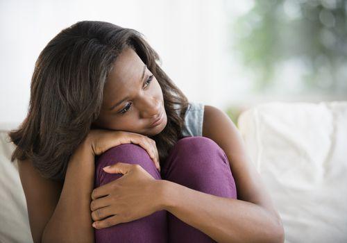 woman hugging her knees