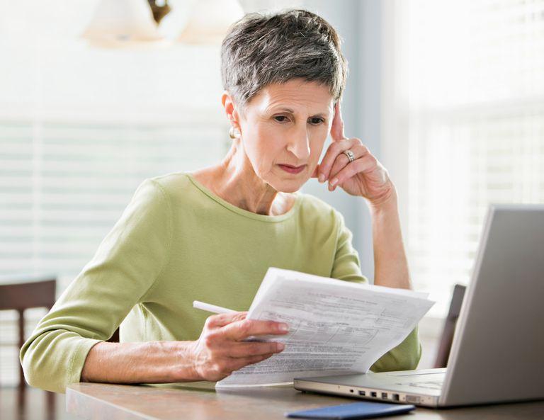 woman looking at medical bills